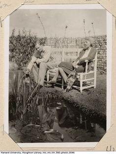 John Lehmann and Virginia Woolf sit on a bench near a pond. Monk's House