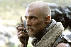 Matthew McConnaghy.. in Reign of Fire ... it was his idea to shave his head