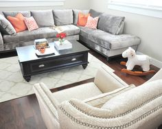 Love the bright pillows and bright rug with the grey couch. Love the bright pillows and bright rug w Living Room Orange, Living Room Grey, Vancouver, Grey Couches, Gray Sectional, Bright Pillows, Couch Design, Velvet Couch, Living Room Inspiration