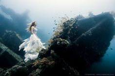 Montreal-based photographer Benjamin Von Wong executed this beautiful and technically ambitious photoshoot 80 feet under the sea in a shipwr...