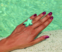 Dima Rashid's signature ring. The finest Jewelry. Turquoise summer flare fitting the trend perfectly