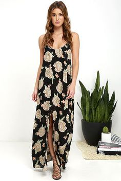 Looking for an excuse to getaway? Slip on the Amuse Society Aryia Black Floral Print Maxi Dress and prepare for paradise! Gauzy black, beige, sage green, and peach floral print viscose sways from crisscrossing, adjustable spaghetti straps to a triangle bodice with ruffled hems, and a shift silhouette. Maxi skirt is finished with a front slit.