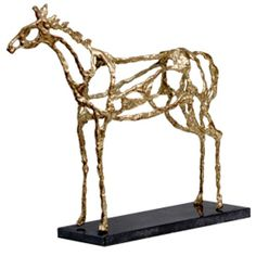 Arabian Horse Statue that is iron with gold leafing. This is not expensive, however I like the light airy feel of the piece. #candelabra #artfulandartists