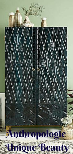 Meticulously Carved By Hand This Art Deco Inspired Armoire Is Stained A Deep Shade Anthropologie