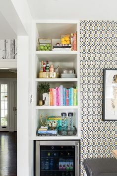 Black+and+gold+eat-in+kitchen+space+boasts+a+wall+clad+in+David+Hicks+Hexagon+Wallpaper+lined+with+Crate+