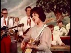 "Kitty Wells - It Wasn't God Who Made Honky Tonk Angels (1952 response record to Hank Thompson's ""The Wild Side of Life"")."