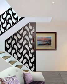 white stairwell with curvy paisley screens and laser cut panels