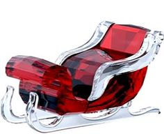 Swarovski Crystal Sleigh Here comes Santa Claus, here comes Santa Claus in this elegant Swarovski cystal sleigh. Sleightis elegantly designed in a classic style and traditional festive colors. Sparkling with a total of 239 facets in red and clear crystal, this along with Santa's Reindeer and Santa Claus would make a very festive holiday display. Decoration object. Not a toy. Not suitable for children under 15