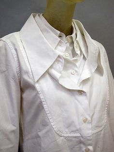 White shirt reinvented with triple collar detail; creative pattern cutting…