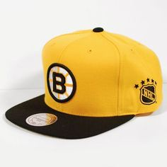Boston Bruins Mitchell & Ness NHL Gold Throwback Vintage Snap back Hat by Mitchell & Ness. $24.99. Help support your favorite team in this NHL Retro Snap Back Hat from Mitchell & Ness. Features embroidered logo's, stylish adjustable snap back, and contrasting team colors for added style. Made of 100% wool and officially licensed by the NHL.