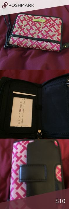 Tommy Hilfiger wallet Tommy Hilfiger pink and white wallet. Can carry credit/debit cards, inside zippered pocket for coins and folded bills. Outside carrying case for small cell phone. Tommy Hilfiger Accessories Key & Card Holders