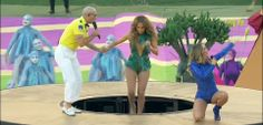 A little awkward! Pitbull helps J-LO out of the elevated paltform that seemed to get stuck...