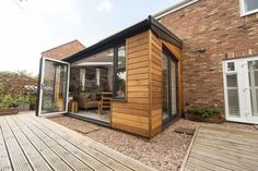Discover a tiled conservatory roof that's also glazed with the Ultraroof. Tiled Conservatory Roof, Lean To Conservatory, Conservatory Extension, Conservatory Ideas, Wooden Cladding Exterior, House Cladding, Glass Roof Extension, House Extension Design, Extension Ideas