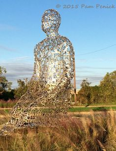 November | 2015 | Digging -  Tolerance, seven kneeling aluminum figures by Barcelona artist Jaume Plensa.