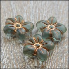 Czech Glass Pressed Puffy Flower Bead - . These beautiful beads are a deep frosted seafoam colour finished with a gold patina. The puffy flowers measure approximately 14mm x 13mm with a 1mm hole running from top to bottom. Sold in packs of 6 beads