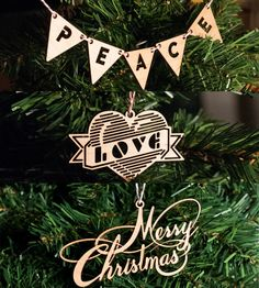 Peace, Love & Merry Christmas Wood Holiday Ornaments by Design des Troy on Scoutmob Shoppe. Awesome laser cut wood ornaments.