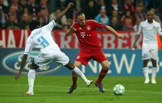 Franck Ribery (R) of Muenchen and Nicolas N'Koulou (L) of Marseille battle for the ball during the UEFA Champions League quarter-final second leg match at Allianz Arena on April 3, 2012 in Munich, Germany.