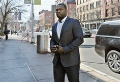 HARTFORD, Conn. (AP) — Rapper 50 Cent is expected in a Connecticut courtroom on Wednesday afternoon to explain photos