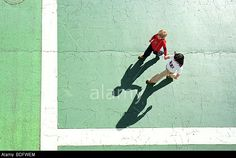 High angle of brother and sister walking. © Cultura Creative (RF) / Alamy