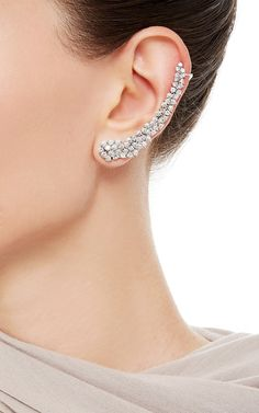This ear cuff by Ana Khouri is rendered in white gold with white diamonds, designed to trace the curve of the ear. Preorder now on Moda Operandi.