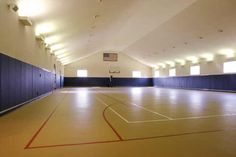 Indoor air conditioned basketball court with full bath, special lighting and unbelieveable storage space
