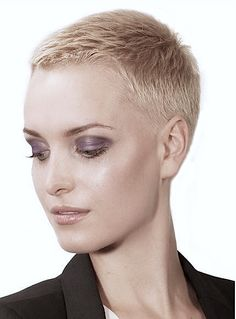 Buzz cut Clipper over comb on top, fade on sides with clippers