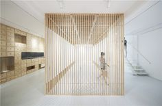 archstudio creates flexible art gallery space using folding screens in beijing