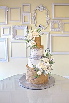Gorgeous wedding cake with layers of glittery gold + a DIY frame backdrop