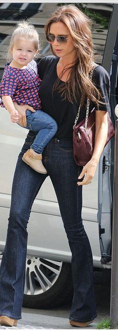Victoria Beckham: Purse and sunglasses – Victoria Beckham Collection  Jeans – J Brand  Shoes – Chloe