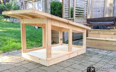 Looking for DIY doghouse plans for a larger breed dog? This DIY dog house (with free building plans), is perfect for our Berner and would easily fit labs, golden retrievers and other breeds in the range. Pallet Dog House, Dog House Plans, Outdoor Paint, Outdoor Dog, Outdoor Ideas, Large Dog Breeds, Large Dogs, Modern Dog Houses, Large Dog House