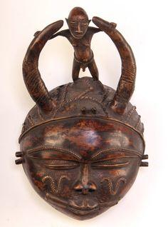 "Vintage Bronze Horned Deity Mask (Cameroon). Size: 12.5"" x 7.5"" x 4""."