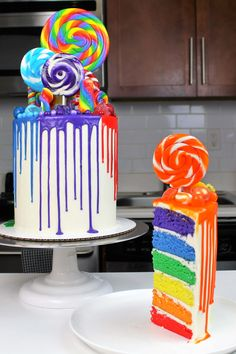 This colorful rainbow drip cake is the ultimate rainbow cake! It's made with rainbow cake layers, a colorful rainbow drip, and tons of rainbow candy!