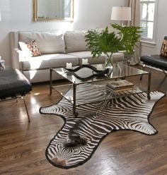 DIRA is a high-end home furnishings designer retail wholesale specializing in luxury handcrafted African lighting, bone jewelry, handbags and purses, skins and rugs, pet collars and Douwlina Rhino book. Trade pricing is available.