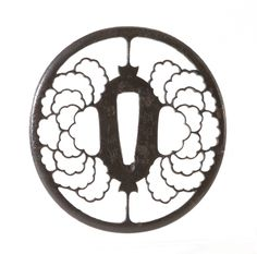 Oval tsuba pierced with a silhouette of peony flowers, Akasaka School, 1840-60 Presented to the collection by Sir C.Hyde Bt in 1930 #bmag130