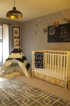 Replace glider with tee-pee and art above crib with stenciled wall design - two great ideas for transitioning to big boy room! #nursery #transitionalnursery