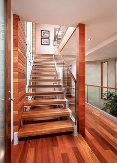 Lyptus flooring pairs beautifully with mahogany walls.