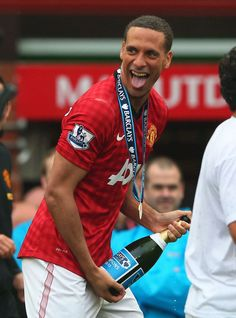 Rio Ferdinand of Manchester United performs a lap of honour with his team-mates