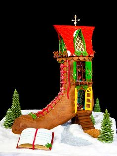 15 Amazing Gingerbread Houses: The inside of this grand-prize-winning boot is outfitted with a triple-tier bunk bed, Christmas tree, ceiling fan, chandelier and rugs. Created by Ashley Howard of Winter Springs, Fla. From DIYnetwork.com