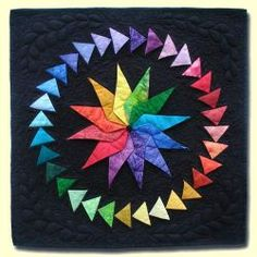 color wheel magic by Mary Anne Ciccotelli - see the article about her five decades of quilting