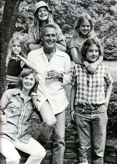 Paul Newman at home in '73 with (clockwise from center left) Clea, Nell, Melissa, Stephanie and Joanne.