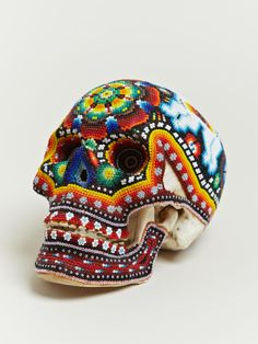 uhhhh, best thing ever?     Our Exquisite Corpse worked with the Huichol people of Mexico to create these beaded skulls. Each beautifully patterned and brightly coloured skull features intricate craftsmanship and are uniquely different from one another.
