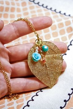 Hey, I found this really awesome Etsy listing at https://www.etsy.com/listing/165439259/gold-filigree-leaf-with-mint-green-resin