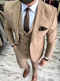 Men's tan three piece suit with brown tie and brown dress shoes. Contact Giorgenti New York today for your best tailored men's custom suits and clothing gentlemen! Mens Fashion Suits, Mens Suits, Dapper Suits, Tan Suit Men, Trendy Fashion, Wedding Suit Styles, Brown Suit Wedding, Brown Suits, Brown Tie
