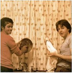 Different....  Michael Jackson and Paul McCartney doing dishes