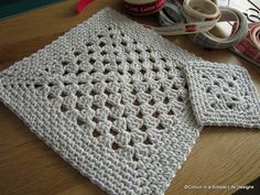 Simple granny square with a border. Maybe use extra bulky yarn or rope and make a square rug