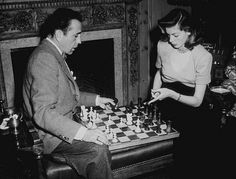 Actor Humphrey Bogart and his wife, actress Lauren Bacall, pictured playing chess, USA, circa (Photo by Archive Photos/Getty. Humphrey Bogart, Lauren Bacall, Vevey, Charlie Chaplin, Cary Grant, Classic Hollywood, Old Hollywood, Hollywood Couples, Hollywood Glamour