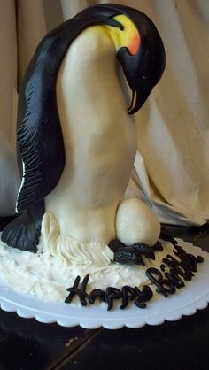 Another pinner wrote: amazing penguin cake - that would be so cute as a gender reveal cake! the cake inside the egg would be pink or blue.