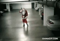 (ANIMATED GIF): A very drunk Santa gets hit by a car --- or is it the other way around? OUCH!
