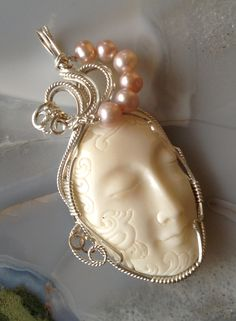 Carved bone face with pink pearls www.2coolcreations.com