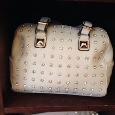 Neutral with studs.  Charming Charlie purse.  Spring 2014.